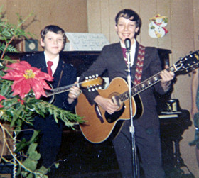 Roger and his brother, Mike performing at the local Eagles Hall 1971 - his first paid gig.